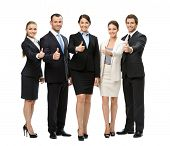 Full-length portrait of thumbing up group of business people, isolated on white. Concept of teamwork