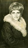 LODZ, POLAND - CIRCA 1960's: Vintage portrait of woman in coat with fur collar
