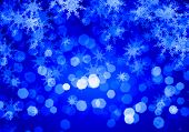 Blue Christmas background with snowflakes and lights