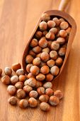 Hazelnuts in wooden scoop