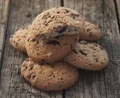 Oatmeal cookies with raisins on vintage wooden background