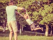 Family Father Man and Son Boy playing Outdoor Happiness emotions Lifestyle with summer nature on bac