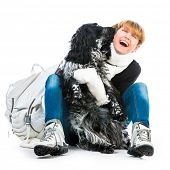 young happy woman with her dog cocker spaniel in a studio isolated on a white background