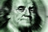 Closeup of hundred dollar bill isolated on Franklin portrait zoomed to eyes