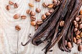 picture of bean-pod  - vanilla pods and coffee beans on wooden background - JPG