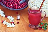 Cranberry Drink With Strung Cranberries And Popcorn In Background
