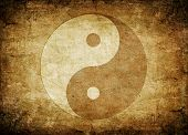 foto of yin  - Ying yang symbol on old dirty background - JPG