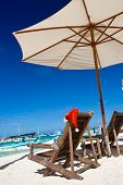 Sun umbrella with Santa Hat on chair longue on  beach