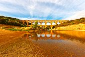 stock photo of aqueduct  - The Ancient Roman Aqueduct Pont du Gard - JPG