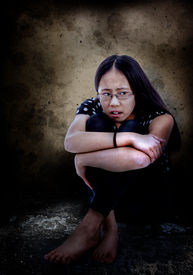 stock photo of tween  - Distressed and frightened Asian tween with copy space - JPG