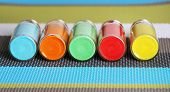 foto of pigment  - Bottles with colorful dry pigments on bright background - JPG