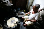 Man Making Puri
