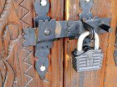 Old lock shaped like a house.