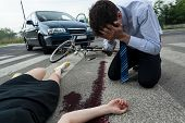 picture of cry  - Crying driver and injured woman at road accident scene horizontal - JPG