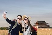 Asian couple travel and selfie in Nara Imperial Palace, Nara, Japan.