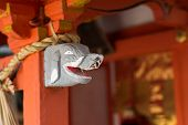 Gray elephant head statue on the  stigmatic of colum in Fushimi Inari Taisha Shrin.