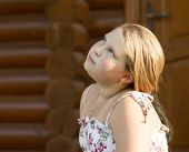 picture of 11 year old  - The beautiful girl of 11 years old is looking up - JPG