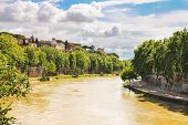 People On The Picturesque Waterfront Of The Tiber River In Rome, Italy