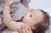 pic of breast-milk  - Close up to Asian Mom Breast Feeding Her Baby Girl - JPG