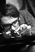 Young Man In Glasses Inhaling Drugs