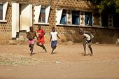 TORIT, SOUTH SUDAN-FEBRUARY 20 2013: Unidentified boys play football in the town of Torit, South Sud