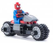 Ankara, Turkey - January 24, 2014: Lego Marvel super hero spiderman on his motorcycle isolated on white background