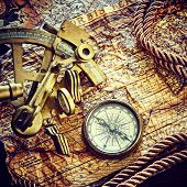 still life with compass,and old map.map used for background is in Public domain. Map source: Libra