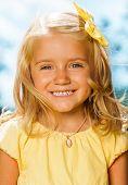 Close portrait of smiling blond little girl