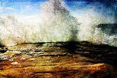 Ocean tidal Wave Crashing into a rock cliff