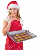 Festive homemaker showing hot cookies on white background