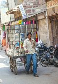 Man Transports Goods  Through The Narrow Roads In Jodhpur