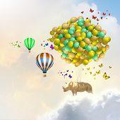 Sunny image of giraffe flying high in sky on aerostat