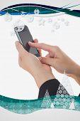 Hands using smart phone against christmas frame