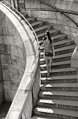 summer, vacation, travel, fashion and people concept - woman in sunglasses and dress walking down stairs with handbag