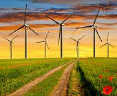 Dirt road  with wind turbines