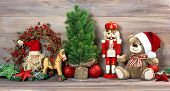 foto of nutcracker  - nostalgic christmas decoration with antique toys teddy bear and nutcracker - JPG