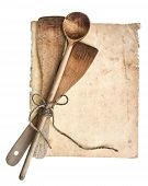 Vintage Wooden Kitchen Utensils And Old Cookbook Page