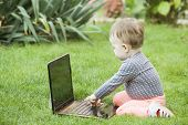 Cute baby girl using a laptop
