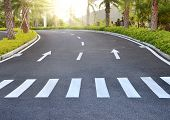 stock photo of traffic rules  - Arrows on asphalt road traffic regulations - JPG