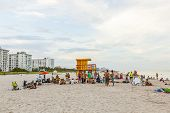 People Enjoy The Beach In The Evening