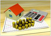 model of small house, golden coins, graph and calculator
