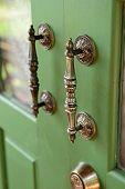 Door Handle On Green Wooden Door