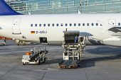 People Load Lufthansa Aircrafts  With Freight At The Terminal 1