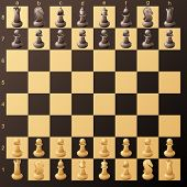 Chessboard with chessmans ready to play