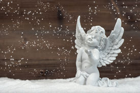 pic of christmas angel  - little white angel with magic lights in snow - JPG