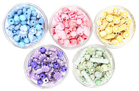 stock photo of crown green bowls  - Beads in glass bowls isolated on white - JPG