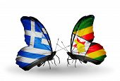 Two Butterflies With Flags On Wings As Symbol Of Relations Greece And Zimbabwe
