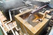 stock photo of boiling water  - Hot water flowing out of pipe hot spring water boiling Beppu Oita Japan - JPG