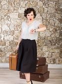 picture of running-late  - Beautiful woman with suitcases checking time and running late - JPG