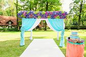 Colorful wedding arch with flowers